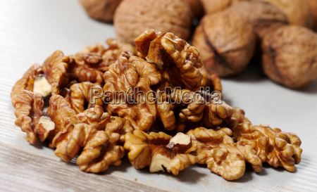 pile of walnuts on a white