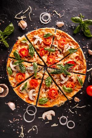 flat lay with italian pizza on