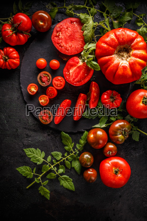 whole red tomatoes and slice of