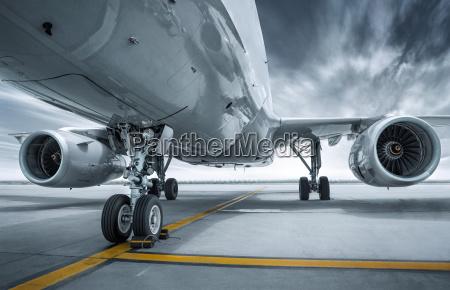 modern airplane at an airfield