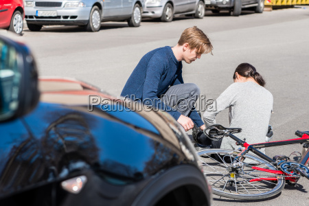 helpful young man giving first aid