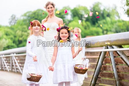 bride in wedding dress with bridesmaids