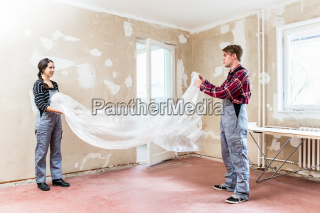 young couple working together at renovation
