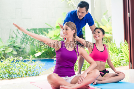 women and personal trainer at fitness