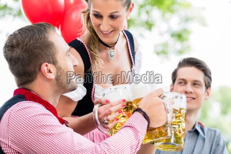 three friends in munich beer garden