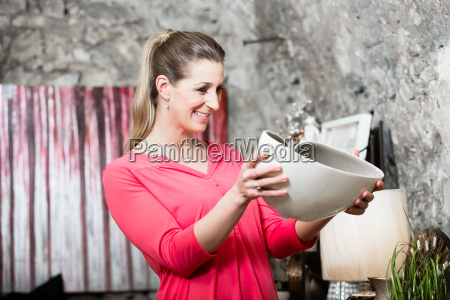 young woman in interior shop interested
