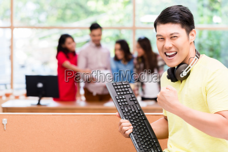 young chinese employee happy for his