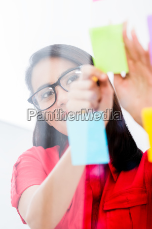 young employee looking at multiple reminders
