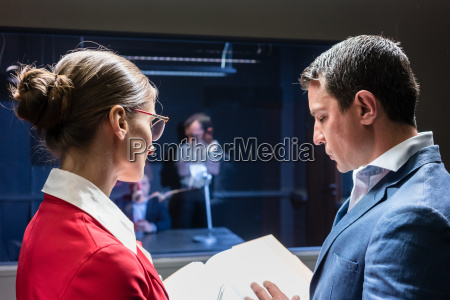 two police detectives analyzing the files