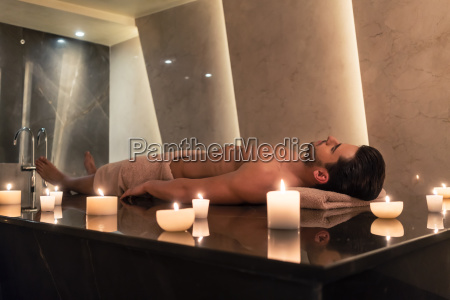man relaxing on massage table at