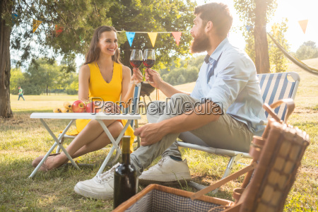 beautiful couple in love toasting with