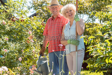 active happy senior woman standing next