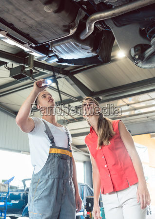 reliable auto mechanic checking the car