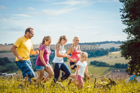 family mother father and kids running