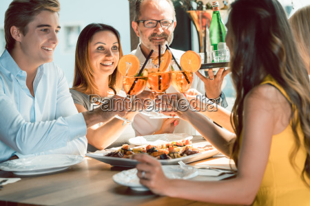 beautiful woman toasting with her boyfriend