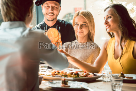 experienced chef congratulated by four people