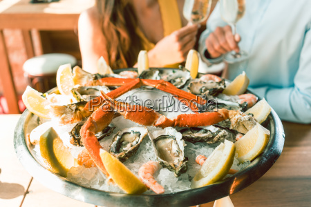 fresh oysters and crabs served on