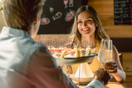 happy couple in love toasting with
