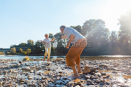 funny senior couple playing with water