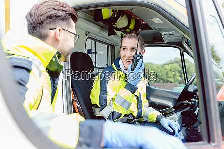paramedics in ambulance in radio contact