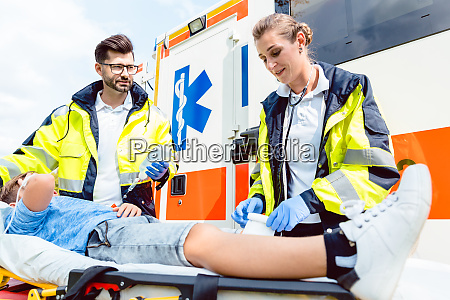 paramedic and emergency doctor caring for