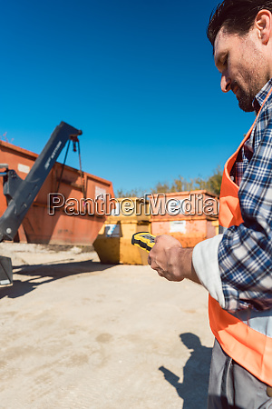 man loading of construction debris container