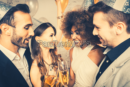 men and women celebrating party while