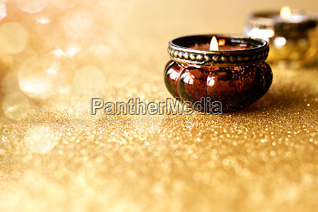candlelights on golden glittering background