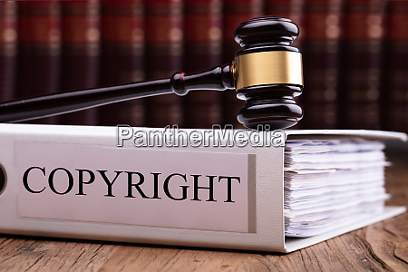 judge gavel on copyright law folder