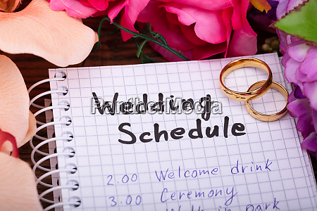 wedding schedule on spiral notepad with