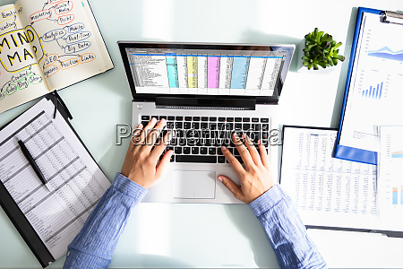 businesswoman analyzing data on laptop
