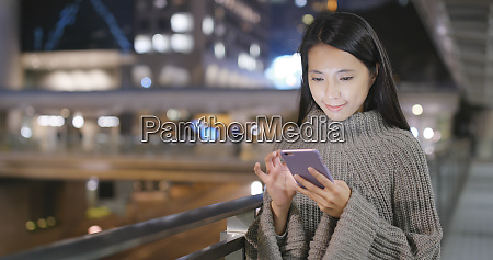 woman using mobile phone in city