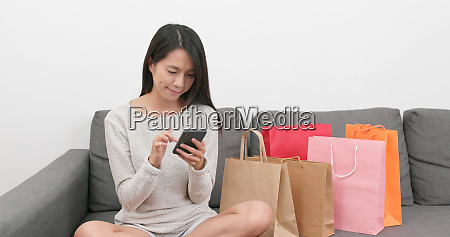 shopping woman using mobile phone for