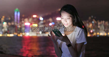 woman sending audio message on smart