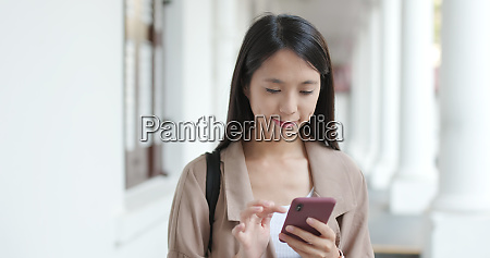woman checking map on cellphone in