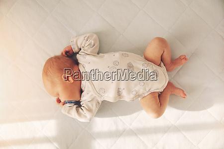 newborn baby boy sleeping in a