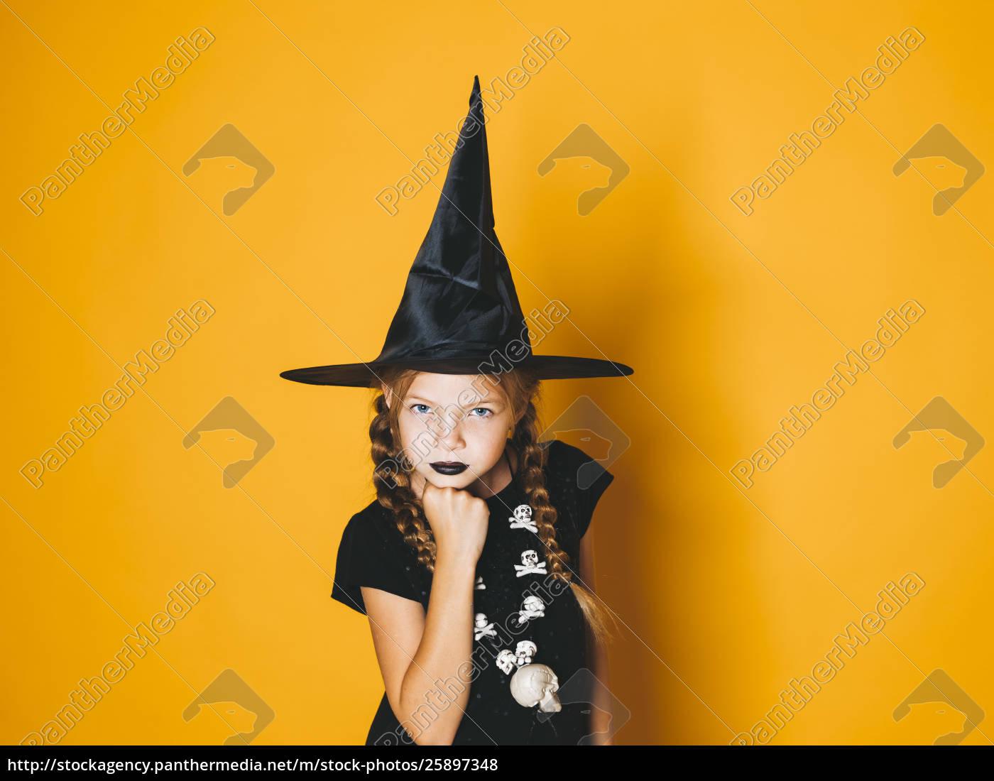 Lizenzfreies Foto 25897348 Junge Halloween Hexe Auf Orangefarbenem Hintergrund Mit