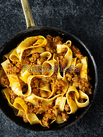rustic italian pappardelle bolognese pasta in