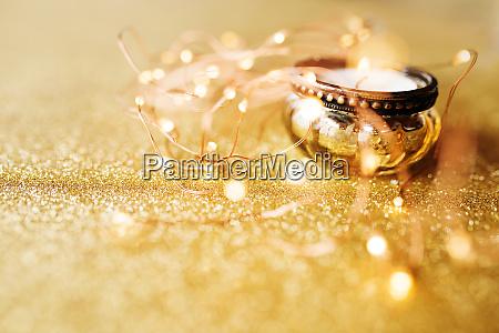 christmas lights on gold sparkling background