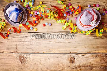 colorful festive carnival border on wood