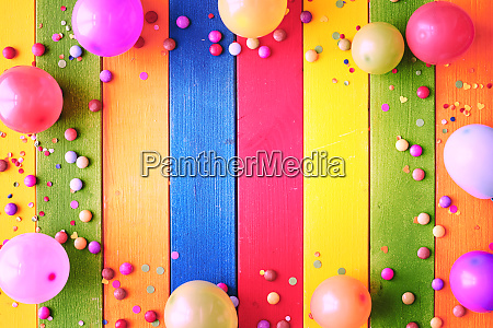rainbow colored carnival background and copy