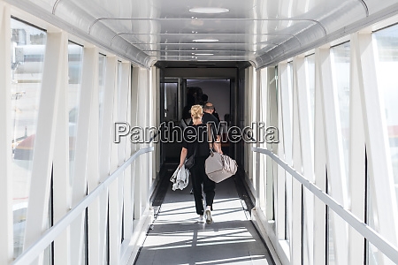 female passenger carrying the hand luggage