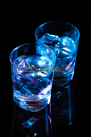 two glasses with vodka and ice