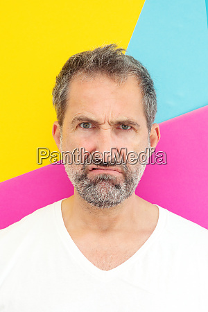 man looking annoyed in front of