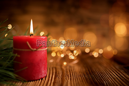christmas candle on wooden table