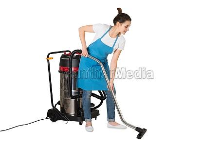 female janitor using vacuum cleaner