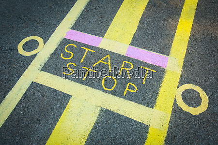 start and stop sign on road