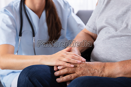 senior man sitting on wheelchair with