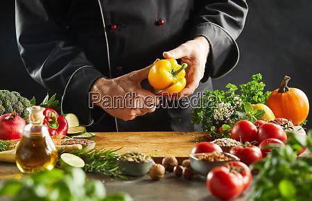 chef preparing a salad form fresh
