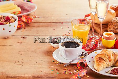 festive carnival breakfast with streamers